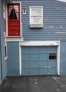 Old Garage door with mystery door.