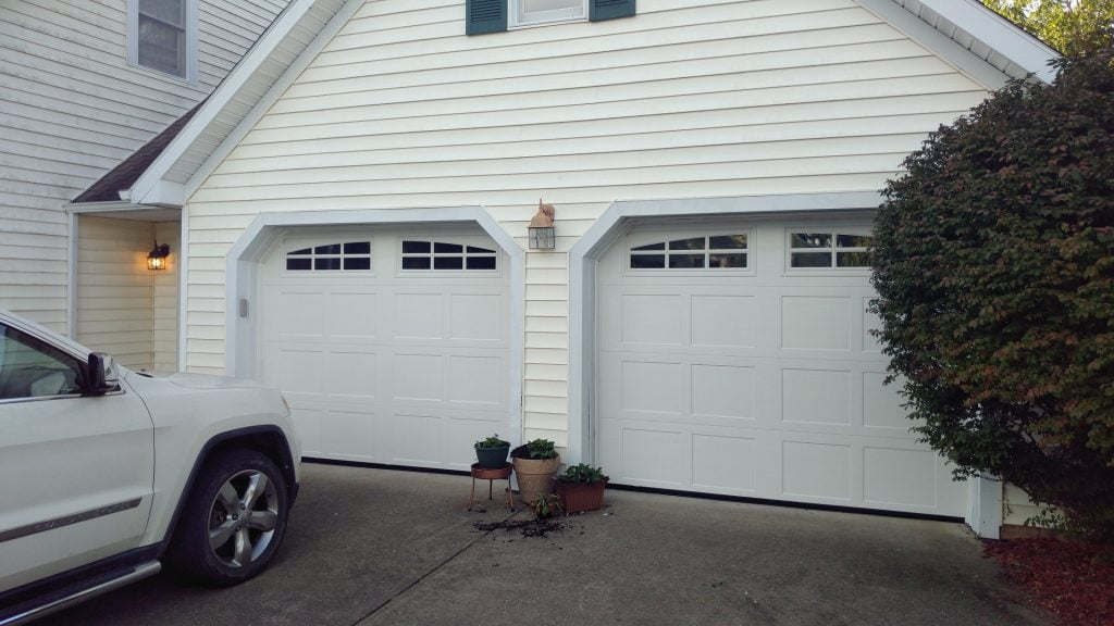 A pair of carriage style garage doors with windows.