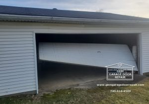 This garage door fell right out of its tracks after an accident while closing the door.